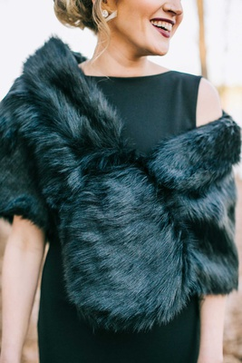 winter wedding bridesmaid dress ideas black dress with fur wrap shawl dark lipstick elegant winter