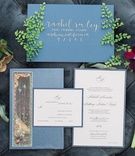 wedding invitations, blue envelopes, calligraphed invitations gold, flowers