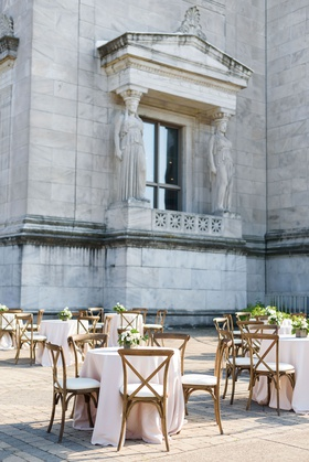wedding at the field museum in chicago outdoor cocktail hour wood vineyard chairs blush linens
