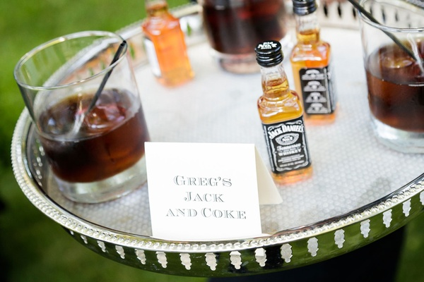 Groom's jack and coke signature drink on silver tray wedding cocktail hour ideas