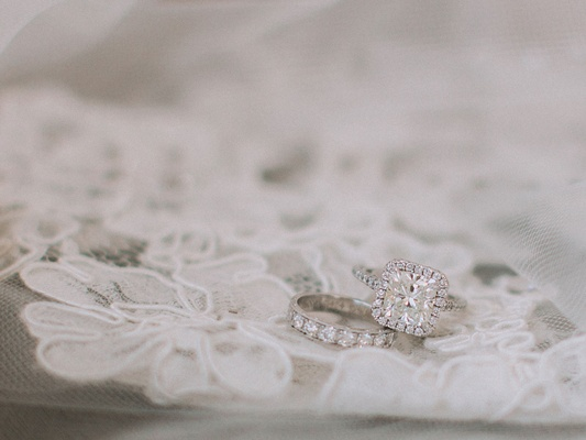 Wedding ring on piece of lace diamond wedding ring and band veil lace