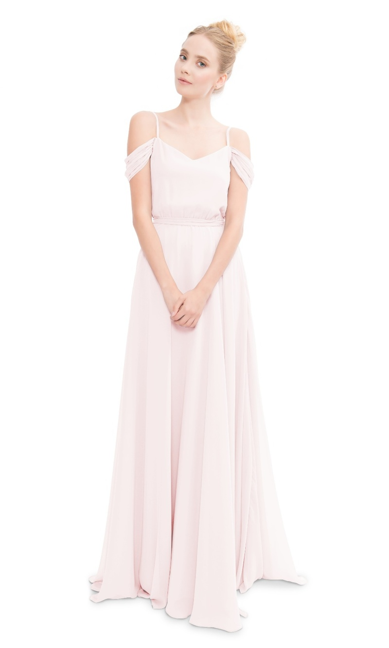 Romantic spaghetti strap gown with off the shoulder details.