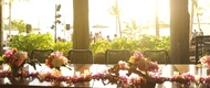 Hawaiian lei, candles, and tropical flower centerpiece