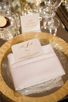 Wedding reception gold rim charger plate white folded napkin rounded corner menu card gold monogram