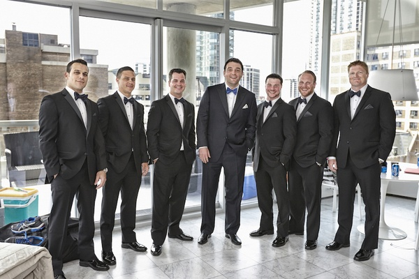 Groom with tux and blue bow tie with groomsmen