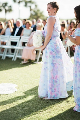 maid of honor in pretty plum sugar dress, soft floral in pink, purple, and blue
