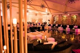wedding reception dancing ballroom black white furniture gold starburst chandelier mid century style