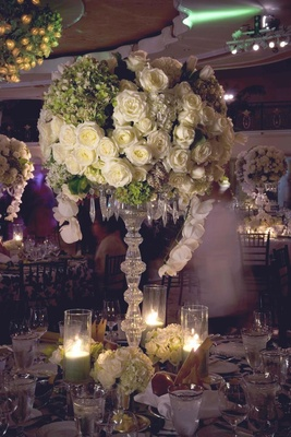Large crystal centerpiece with green and white flowers