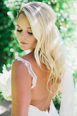bride in galia lahav, false eyelashes, soft waves blonde hair, subtle makeup