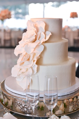 White three layer wedding cake with sugar flower