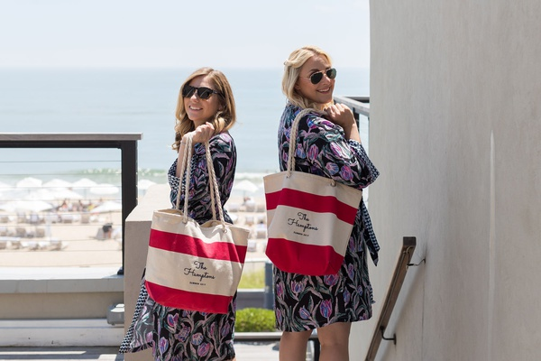 bridesmaids in robes sunglasses with red white stripe bag with rope handles