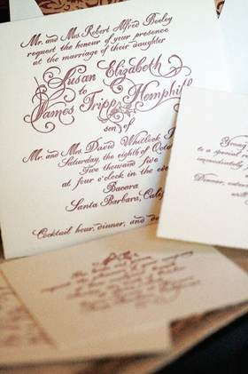 Ivory wedding invitation with red calligraphy lettering