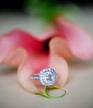 Diamond engagement ring on pink flower