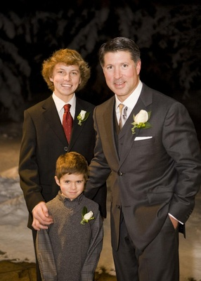 Man with son and step son in snow