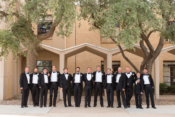 Groom with groomsmen in Midland Texas in tuxes