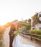 bride in wedding dress bella bianca bridal couture large bouquet kiss groom sunset golden hour