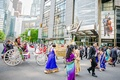indian-american groom on horse-drawn carriage for baraat in new york city