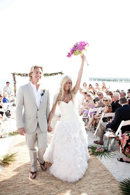 Wedding on sand and groom in flip flops