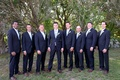 Groom and groomsmen in dark suits with calla lily boutonnieres in Martha's Vineyard