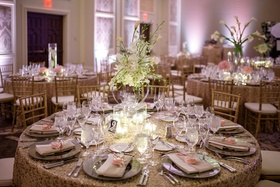 modern lucite display of calla lilies and orchids at wedding reception