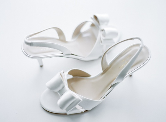 Bride's Kate Spade white slingback heels with bows