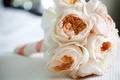 Light pink and orange garden roses in bridesmaid bouquet