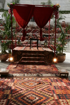 Amphitheater wedding ceremony with vibrant Moroccan rugs