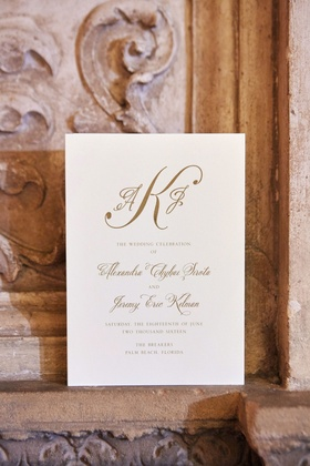 Gold monogram and script on ceremony program for wedding at The Breakers