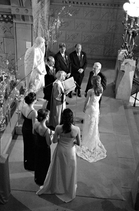 Black and white photo of bride and groom exchanging vows at the Pennsylvania Academy of the Fine Art