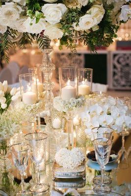 wedding reception centerpiece white rose white orchid white tulip flowers candles crystal