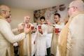 groom groomsmen cheers hotel room indian hindu wedding drinking celebrating traditional friends