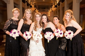 Bride with bridesmaids in mismatched dark dresses