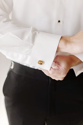 groom with golden cuff links engraved with his initials
