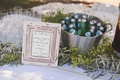 Wedding ceremony outdoors rustic frame calligraphy sign with lemonade bucket of pellegrino and wine