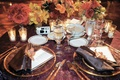 Gold and maroon wedding reception table