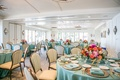 pastel blue linens with colorful flowers inside restaurant