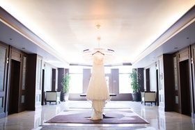 strapless winnie couture lace dress hanging in hotel lobby
