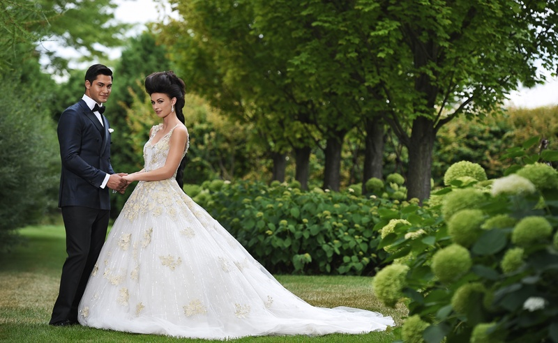 bride in ines di santo julia, ball gown with gold appliques, marie antoinette hair