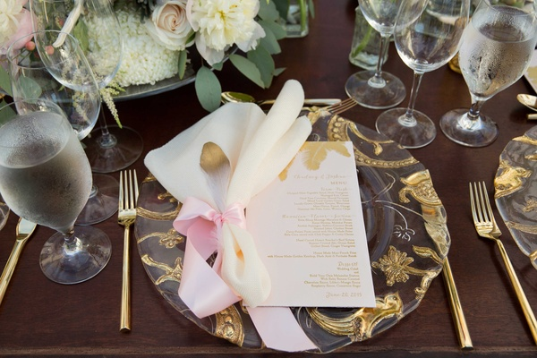Chudney Ross wedding reception gold pattern charger gold flatware gold dipped feather pink ribbon