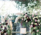 rustic chuppah for fall wedding with blush and marsala flowers, pampas grass
