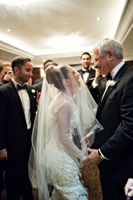 "bride in oscar de la renta ""snowflake"", laughs with father during bedeken ceremony"