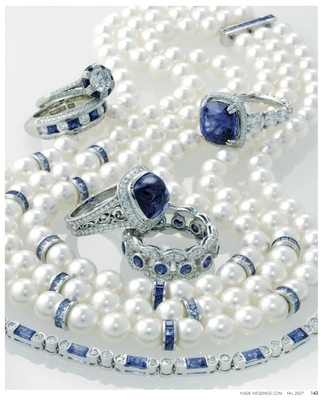 Diamond and sapphire platinum anniversary band by A. Jaffe. Platinum, diamond, and sapphire engageme