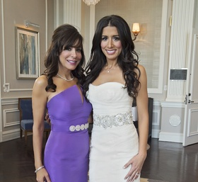 Bride in Vera Wang wedding dress with mother of bride in purple Elde De La Rosa gown