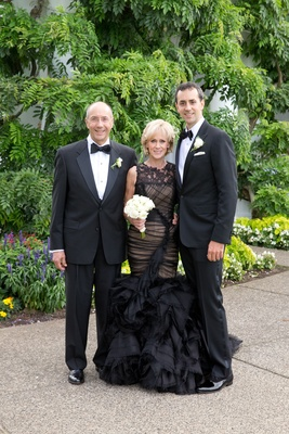 Groom with father and mother of groom in black mermaid dress
