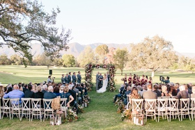 ojai valley inn wedding, outdoor jewish ceremony, floral chuppah, wedding in a field