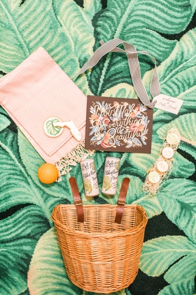 Welcome basket with Belvoir Elderflower drink, macarons, an orange, and cookies palm print florida