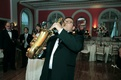 Saxist musician entertaining guests at reception