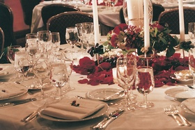 White linens and candlesticks with red florals