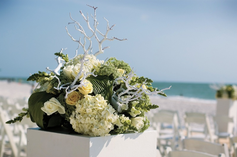 bouquet of green and yellow flowers with white branches in square white box