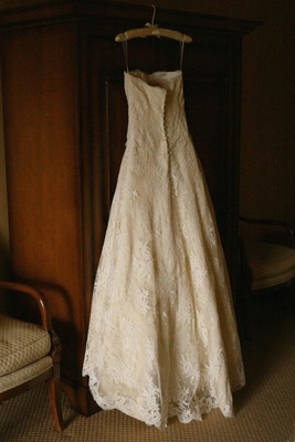 Monique Lhuillier wedding dress on hanger